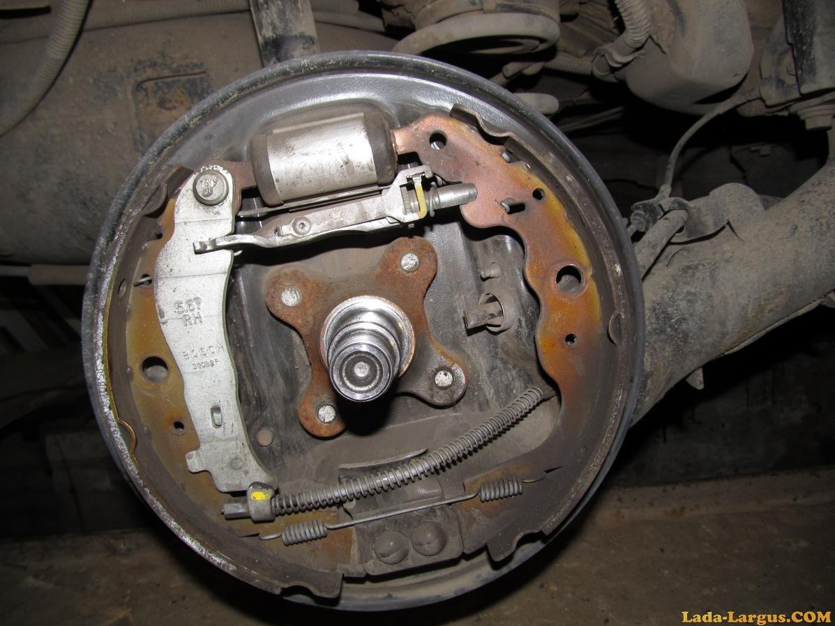 Замена передних тормозных колодок на Лада Ларгус: фото и видео 61
